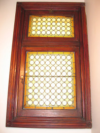 Internal window at the landing a few steps up from the main hallway.
